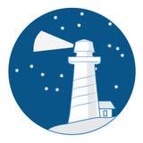 在深蓝背景的灯塔 免版税图库摄影