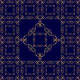 在深蓝背景的豪华金黄装饰品 免版税库存图片