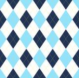 在深蓝,浅兰&白色的无缝的argyle样式与黄色针 库存图片