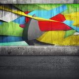 在混凝土墙上的抽象3d街道画片段 免版税图库摄影