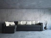 在混凝土墙附近的沙发 免版税图库摄影