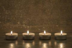 在混凝土的茶蜡烛 库存照片