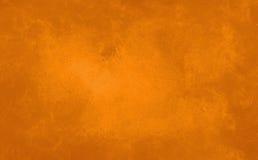 在温暖的秋天万圣夜颜色的使有大理石花纹的橙色背景 免版税库存图片