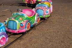 在游乐园的五颜六色的去推车 免版税图库摄影