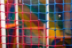 在游戏室的五颜六色的安全滤网 库存照片