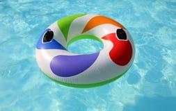 在游泳池的游泳圆环 免版税图库摄影