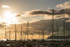 在游艇后的日落在小游艇船坞在酒吧城市,黑山 免版税库存图片