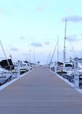 在游艇港口的日落 免版税库存图片