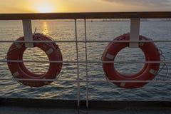 在游轮的甲板的橙色救护设备 免版税图库摄影