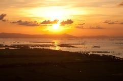 在湄公河三角洲的美好的日落 库存照片