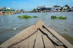 在湄公河的木小船在越南 库存照片