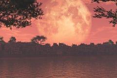 在湖和城镇的日落 免版税库存照片