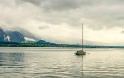 在湖的一条偏僻的小船 库存图片