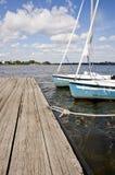 在湖的二条蓝色游艇 库存照片