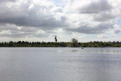 在湖的孤立渔船 库存图片