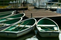 在湖的小船有微型样式的 图库摄影