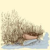 在湖的小船 皇族释放例证