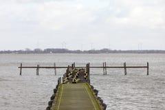 在湖的恶劣天气有栈桥的 免版税图库摄影