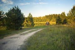 在湖的日落在秋天 免版税库存照片