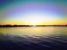 在湖的日落起波纹水 免版税库存图片
