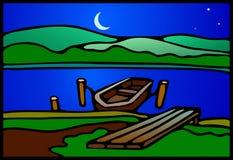 在湖的暮色小船 免版税库存照片