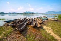 在湖的木小船 免版税图库摄影