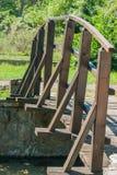 在湖的木篱芭桥梁 免版税库存照片