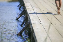 在湖的木脚桥梁 库存照片