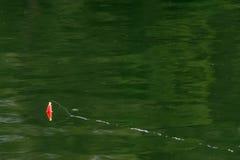 在湖的浮子反射 免版税库存照片