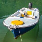 在湖的空的汽艇 库存照片