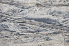 在湿沙子的样式 图库摄影