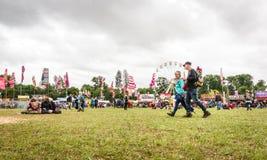 在湿Womad节日的成人 库存图片