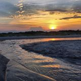 在潮汐水池的日落 免版税库存照片