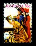在澳大利亚打印的邮票在仪式的教会显示一个小组的图象男孩在价值在36分 图库摄影