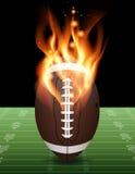 在火例证的橄榄球 库存图片