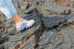 在火山的流石头的英尺  免版税库存图片