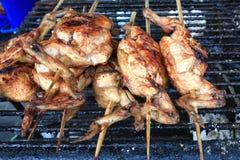 在火炉的烤鸡 免版税库存照片