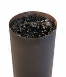 在火炉管子的木馏油 免版税库存照片
