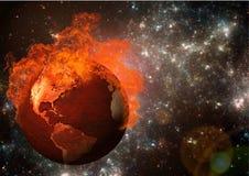 在火焰的地球 库存图片