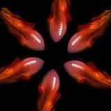 在火的橄榄球 免版税库存照片