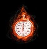 在火的秒表 免版税库存图片