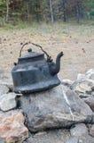 在火的水壶 免版税图库摄影