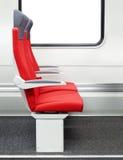 在火车的乘客椅子 免版税库存图片
