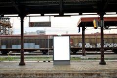 在火车站的广告牌显示 库存照片