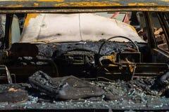 在火以后的汽车内部 免版税库存图片