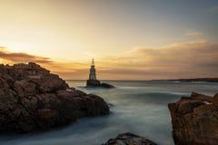在灯塔的日出在阿赫托波尔,保加利亚 免版税库存图片