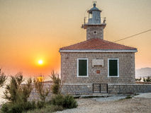 在灯塔的日落 免版税库存照片