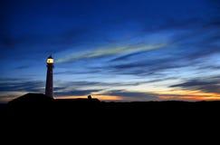 在灯塔的日落 免版税图库摄影