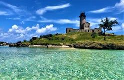 在灯塔的看法在蓝色海湾盐水湖毛里求斯 免版税库存图片