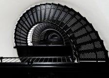 在灯塔螺旋形楼梯里面 免版税库存图片